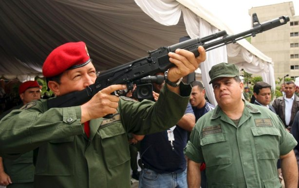 File photo of Venezuelan President Hugo Chavez holding a rifle in Caracas